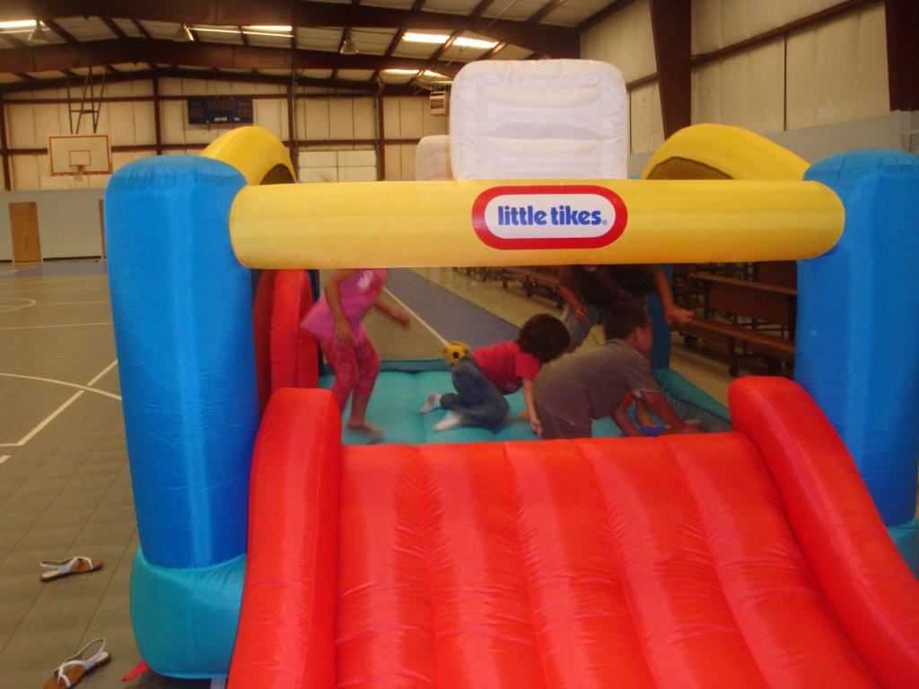 wonderful little tikes bounce house made of caoutchouc with red slide for kids play room ideas