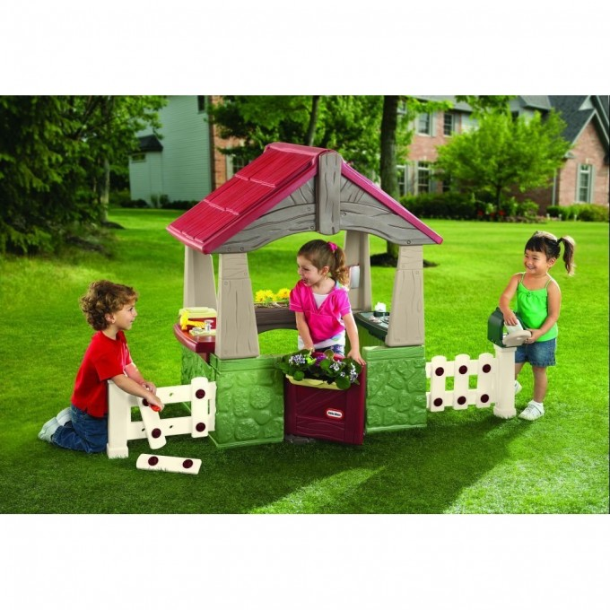 Wonderful Little Tikes Playhouse Made Of Plastic With Red Roof And White Railing For Playground Decor Ideas