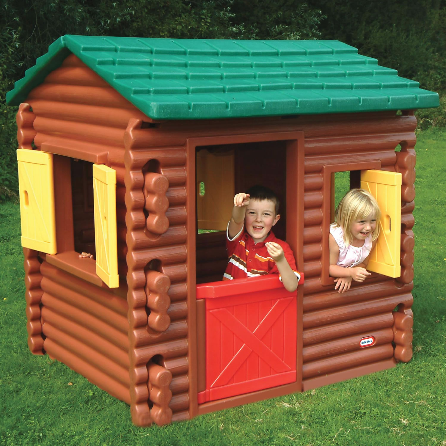 Wonderful Little Tikes Playhouse With Brown Siding And Green Roof On Green Grass For Cute Playground Decor Ideas