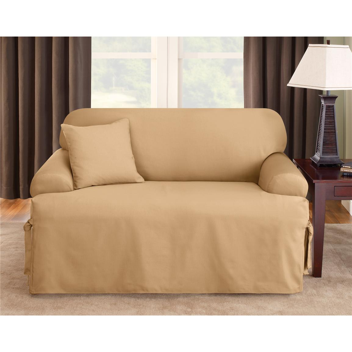 wonderful sofa with cream surefit cover next to a brown wooden nightstand with table lamp for living room decor ideas