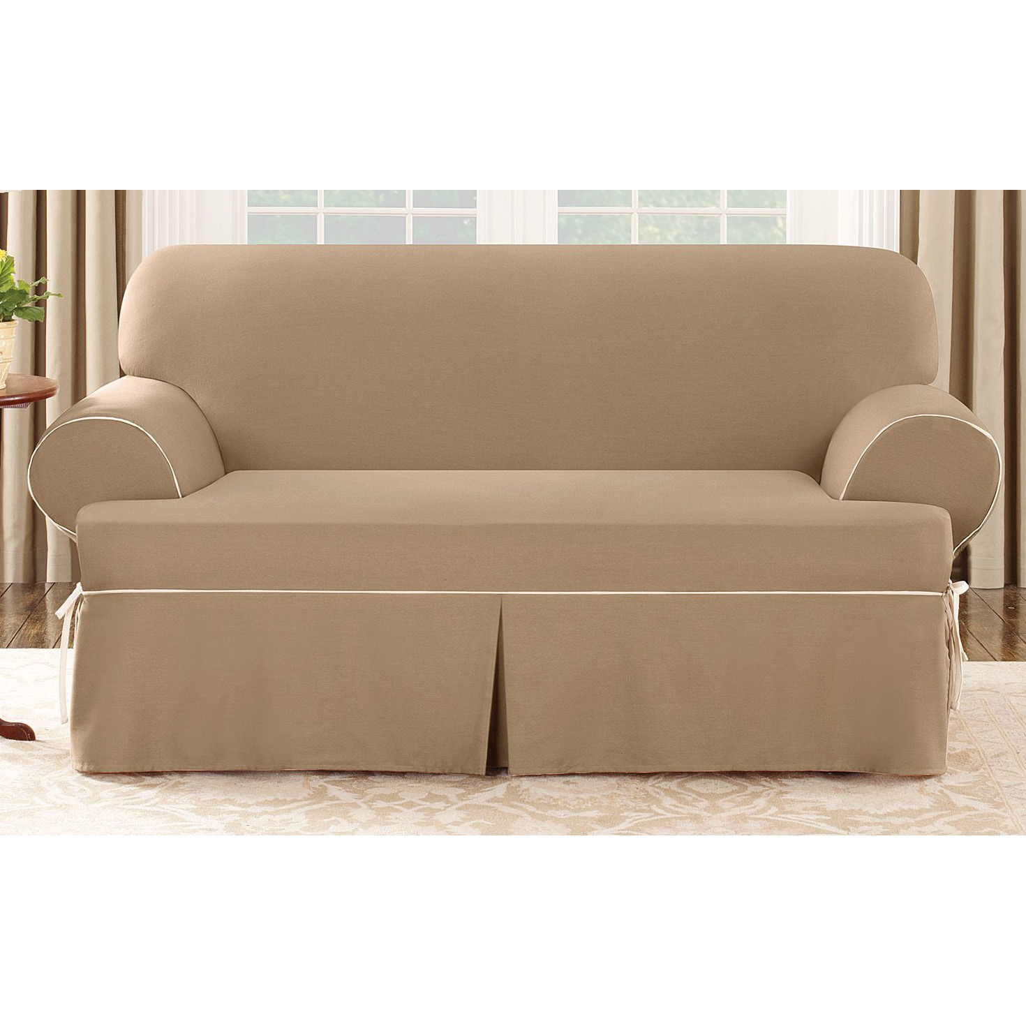 wonderful sofa with tan surefit cover before a glass door with beige curtain for living room decor ideas