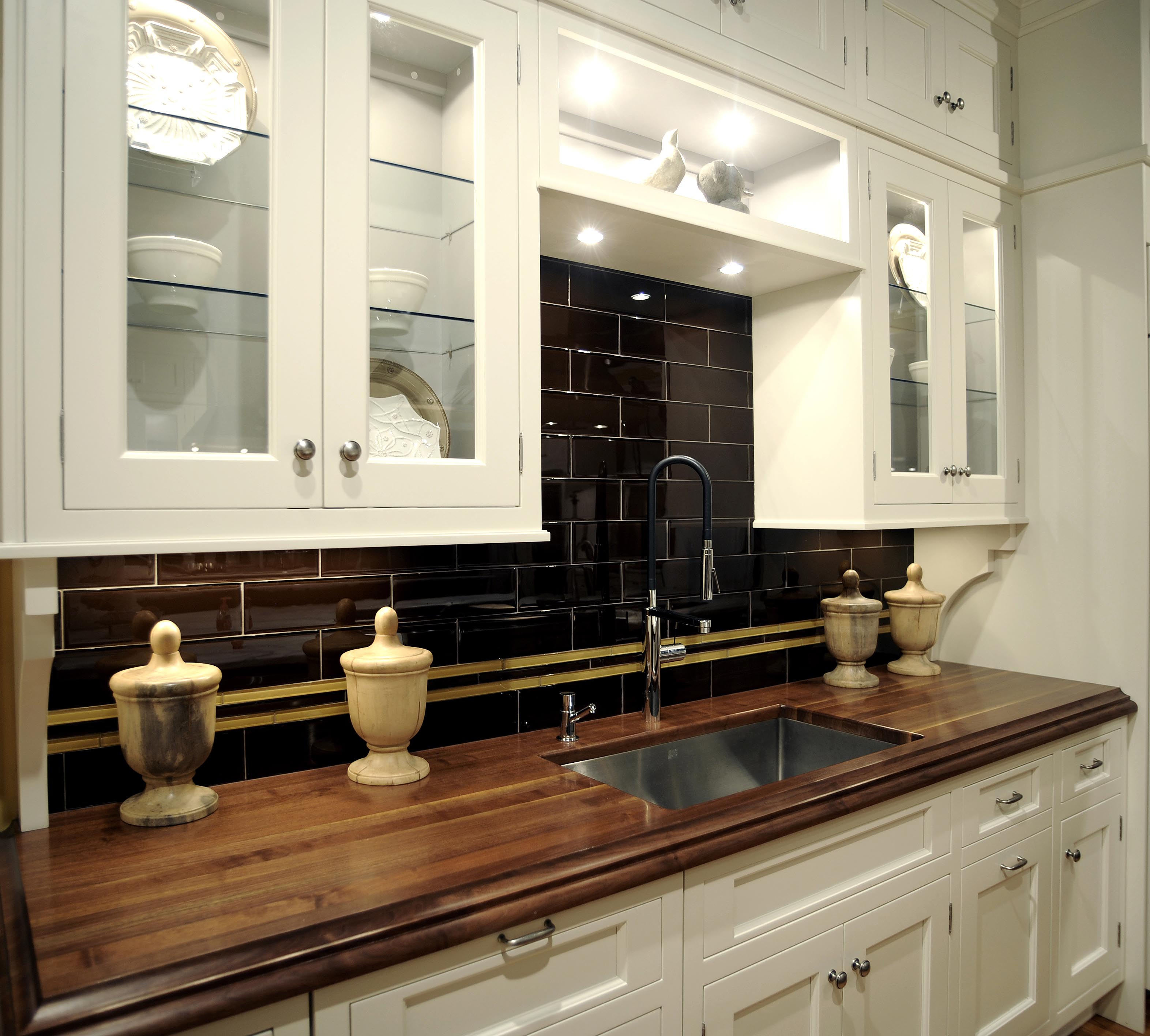 wonderful white wooden kitchen cabinet with silver handle and wilsonart laminate countertops plus dark tile backspash for kitchen decor ideas