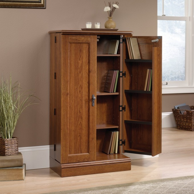 Wonderful Wooden Book Case With Door By Sauder Furniture On Wooden Floor Which Matched With Tan Wall For Living Room Decor Ideas